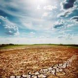 Desert earth under dramatic sky Stock Photos