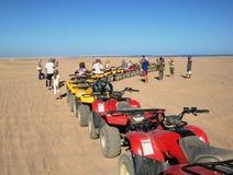 Desert Egypt quads tourists Stock Photography