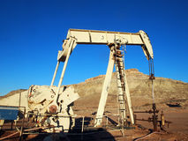 Desert Energy. Pumping hydrocarbons at a desert well on a winter afternoon Royalty Free Stock Images