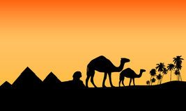 Desert exotic egypt scenario. Vector illustration as silhouette of exotic panorama with pyramids, palms and dromedaries, at sunset Stock Photo