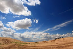 Desert expedition. Vehicles in the desert under the cloudy sky Royalty Free Stock Photo