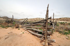 Desert fence. Old wooden fence stands alone in vast desert royalty free stock image