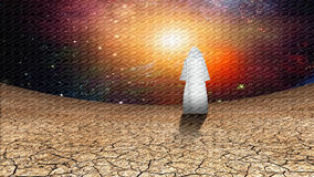 Desert figure. Desert and galactic sky with wandering cloaked figure Stock Photo