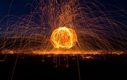 Desert Fire Orb. Orb of hot sparks streaking through the night sky Royalty Free Stock Image