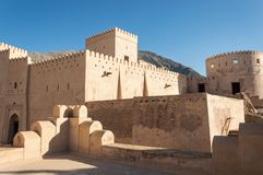 Desert fortress. Courtyard of a desert fortress with towers and walls Royalty Free Stock Photography
