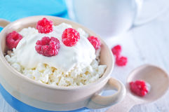 Desert. Fresh cottage with raspberry and sour cream Stock Image