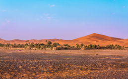 Desert frontier. The frontier in the Sahara desert between the flat rocky land and the sand dunes. This interface is perfect for the construction of hotels, used Stock Photography