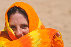 Desert Girl. An beautiful middle-age woman is looking to the camera with an enigmatic expression Stock Image