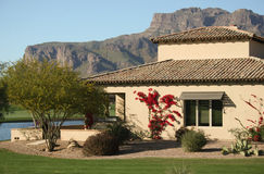 Desert golf course home. Luxury home nestled next to a mountain, lake and famous desert golf course Royalty Free Stock Images