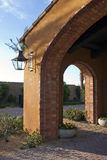 Desert golf course home entrance arch and lantern Stock Photo