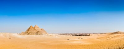 Desert with the great pyramids of Giza stock photography