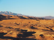 Desert and high ATLAS MOUNTAINS range landscape in central Morocco. Seen from ksar of Ait-Ben-Haddou near Ouarzazate city with clear blue sky in 2017 warm sunny Stock Photo
