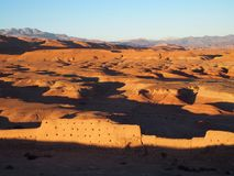 Desert and high ATLAS MOUNTAINS range landscape in central Morocco. Seen from ksar of Ait-Ben-Haddou near Ouarzazate city with clear blue sky in 2017 warm sunny Royalty Free Stock Images