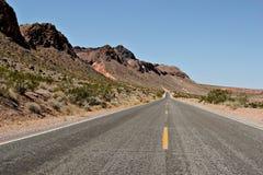 Desert highway. Tranquil desert highway going nowhere Royalty Free Stock Image