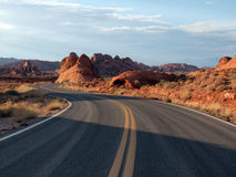 Desert Highway. S turns through Nevada red sandstone formations Stock Photography