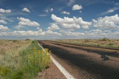 Desert highway. Empty desert highway and clouds Royalty Free Stock Image