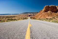 Desert highway. Lone desert highway from the ground Royalty Free Stock Photo