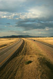 Desert highway. Four lane desert highway stretching to mountains Stock Image