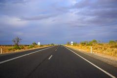 Desert highway. Highway through desert landscape in Australia stock image