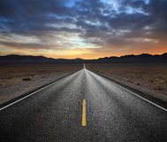 Desert Highway. And Mountains At Sunset, Death Valley National Park, California royalty free stock photos