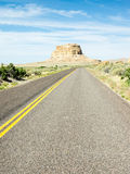 Desert Highway Approaching Chaco Canyon in New Mexico Royalty Free Stock Image