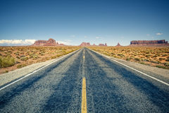 Desert highway leading into Monument Valley Royalty Free Stock Photo