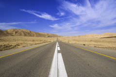 Desert highway and sky Royalty Free Stock Image