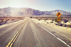 Desert highway with speed limit sign, USA. Stock Photography