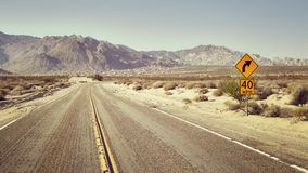 Desert highway with speed limit sign, USA. Royalty Free Stock Images