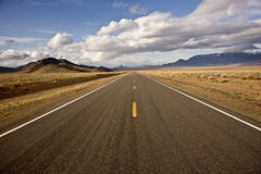 Desert Highway and Spring Sky Stock Images