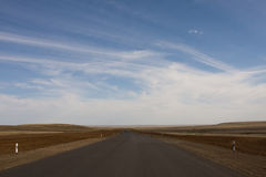 Desert highway in the steppe Stock Photo