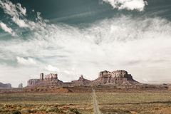 Desert highway to monument valley Royalty Free Stock Photo