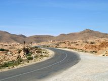 Desert highway in Tunisia Royalty Free Stock Photo