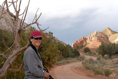 Desert Hiker. A woman hiker smiles as she rounds a beautiful corner in Southwest Utah's beautiful backcountry Royalty Free Stock Image
