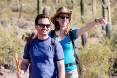 Desert Hiker Pointing with Friend Royalty Free Stock Photos