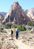 Desert Hikers. A couple hiking in Red Rock , Pine Creek Canyon Trail, Las Vegas Nevada royalty free stock photo