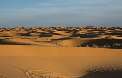 Desert hills. Erg Chebbi is one of Morocco's two Saharan ergs – large dunes formed by wind-blown sand –. The other is Erg Chigaga near M'hamid. Its Royalty Free Stock Photos