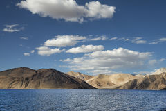 Desert hills and deep blue mountain lake Stock Images
