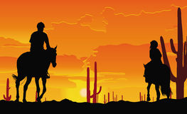 Desert horse ride, father and child at sunset Royalty Free Stock Image