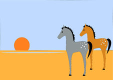 Desert Horses. Stylistic drawing of two spotted horses in front of a setting sun in the desert Royalty Free Stock Image