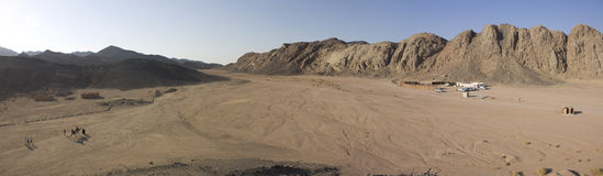 Desert in Hurghada with beduine buildings Stock Photo
