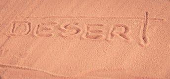 `Desert`  inscription on the sand Royalty Free Stock Photos