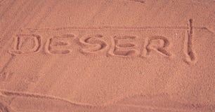 `Desert`  inscription on the sand Royalty Free Stock Photo