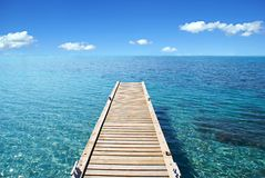 Desert Island. View of  the Mediterannean sea from a wood deck Royalty Free Stock Photography