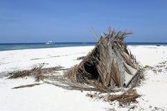 Desert island beach shelter. Small shelter built on tropical desert island beach in the sulu sea near palawan Royalty Free Stock Photos