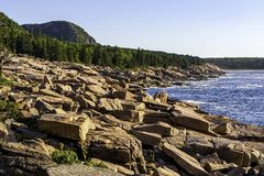 Desert Island Coast. Rocky coast of Desert Island Maine with mountain in the background royalty free stock photos