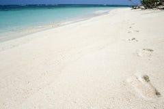 Desert island footprints tropical beach background royalty free stock photo