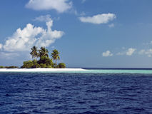 Desert Island - The Maldives. A small desert island in The Maldives in the Indian Ocean Royalty Free Stock Photography