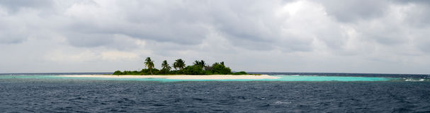 Desert island in sea Stock Photography
