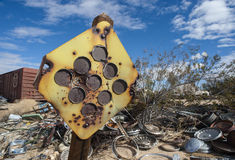 Desert junkyard traffic sign Stock Image